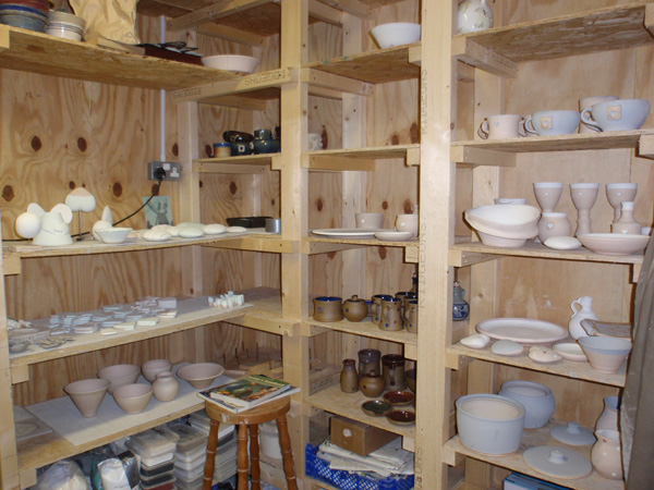 Pottery shelves being filled